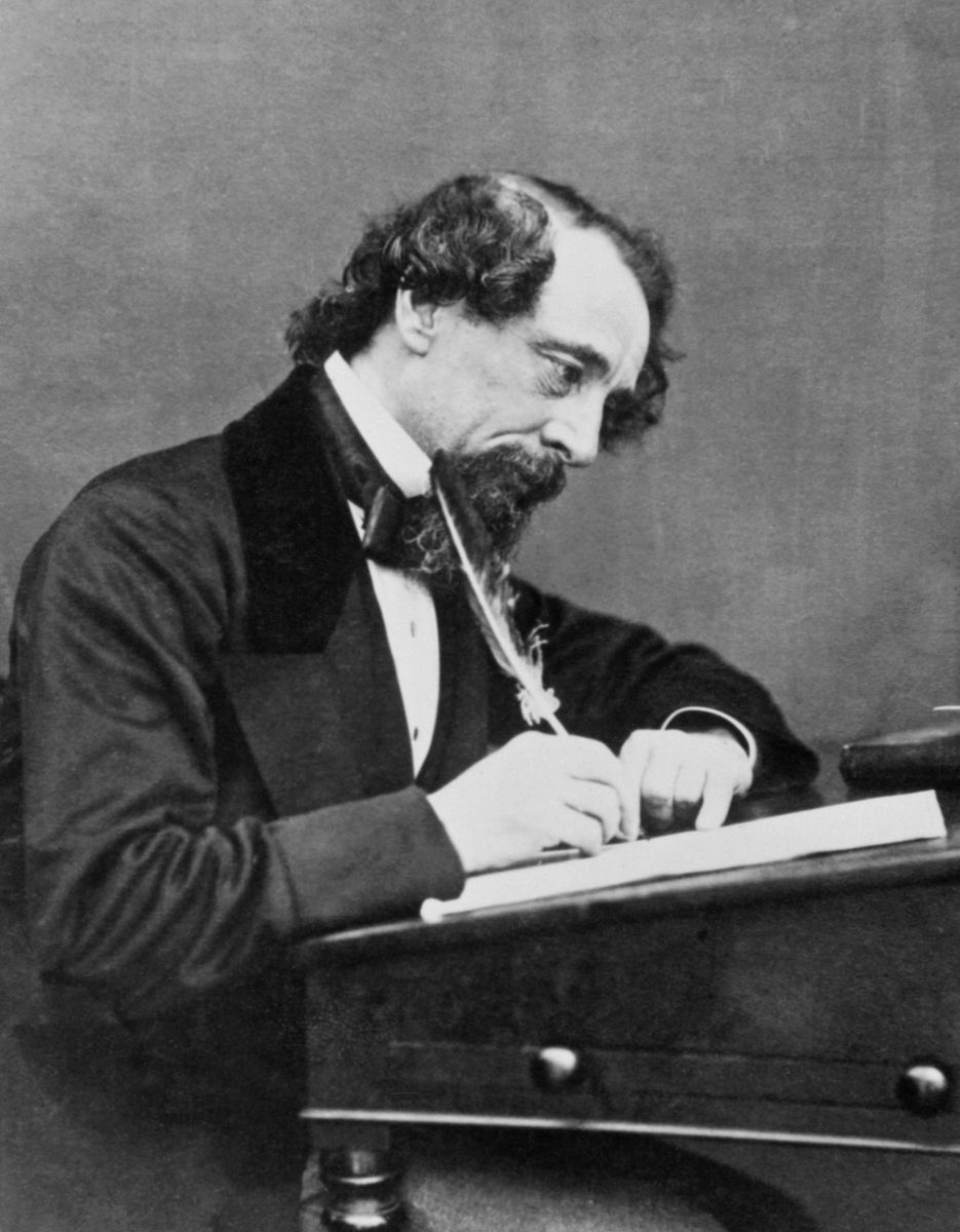 Image of Charles Dickens writing.